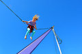 Little girl on bungee trampoline age concept risk with copy space Stock Photography