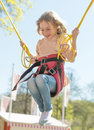 Little girl on bungee trampoline with cords Royalty Free Stock Photo