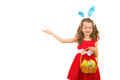 Little girl with bunny ears making presentation and easter eggs welcoming to copy space isolated on white background Royalty Free Stock Photography