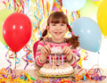 Little girl with cake and balloons birthday party happy Stock Image