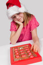 Little girl with candies in box Stock Photos