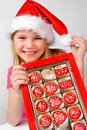 Little girl with candies in box Royalty Free Stock Photo