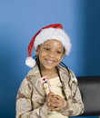 Little girl with a candy cane Royalty Free Stock Image