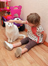 Little girl cat sitting floor home Royalty Free Stock Photography
