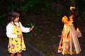 Little girl celebrate lag ba omer jewish holiday by lit a bonfire outdoor Royalty Free Stock Photography