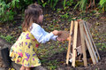 Little girl celebrate lag ba omer jewish holiday by preparing a bonfire outdoor Stock Image