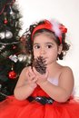 Little girl celebrating christmas lying near tree at home Stock Photography
