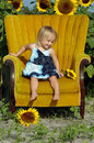 Little girl in chair Royalty Free Stock Photo