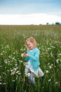 Little girl in a chamomile field Royalty Free Stock Photo