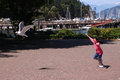 Little Girl Chasing Seagull Royalty Free Stock Photos
