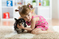 Little girl with Chihuahua dog in children room. Kids pet friendship Royalty Free Stock Photo