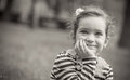 Little girl child black and white portrait of cute in a park close up of beautiful outdoors greyscale Royalty Free Stock Image