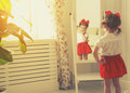 Little girl child fashionista looking in the mirror at home Royalty Free Stock Photo
