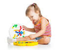 Little girl child playing toy Royalty Free Stock Photo