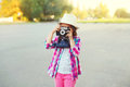 Little girl child with retro camera doing snapshot Royalty Free Stock Photo