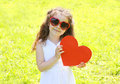 Little girl child in sunglasses with big red paper heart Royalty Free Stock Photo
