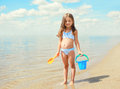 Little girl child with toys playing and having fun on the beach Royalty Free Stock Photo