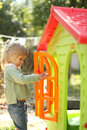 Little girl with a children's playhouse Royalty Free Stock Image