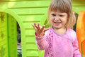 Little girl with a children's playhouse Stock Photo