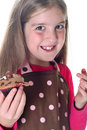 Little girl with chocolate cupcakes Royalty Free Stock Photo