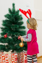 Little girl with a christmas gift happy at home Royalty Free Stock Images