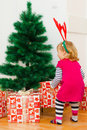 Little girl with a christmas gift at home Stock Photo