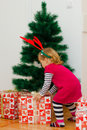Little girl with a christmas gift at home Royalty Free Stock Photos