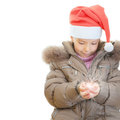 Little girl Christmas hatkeeps Stock Photos