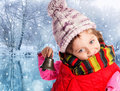 Little girl in christmas landscape Stock Images