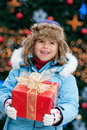 Little girl with Christmas present Royalty Free Stock Photo