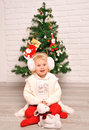 Little girl and christmas tree Royalty Free Stock Photos
