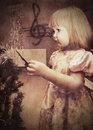 Little girl with christmas tree in the old style Stock Photography