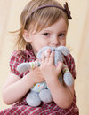 Little girl clasp toy rabbit to one's bosom Royalty Free Stock Images