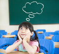Little girl in the classroom with thinking Stock Photos