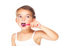Little girl cleaning her teeth on white Stock Images