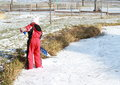 Little girl cleaning ice on pond Royalty Free Stock Photography
