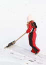 Little girl cleaning ice from snow Royalty Free Stock Images