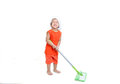 Little girl cleaning with a mop. Royalty Free Stock Photo