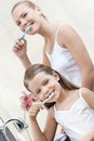 Little girl cleans teeth with her mom is happy to clean Royalty Free Stock Photos