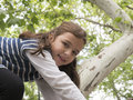 Little girl climbed in a tree Royalty Free Stock Photo