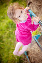 Little girl climbs on horizontal Royalty Free Stock Photos