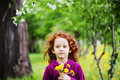 Little girl closed her eyes and breathes yellow dandelions in th the field Stock Photography