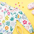 Little girl clothing and accessories - pretty dress, sandals, sunglasses. Baby summer fashion concept. Royalty Free Stock Photo