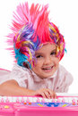 Little girl with colorful wigs Stock Image