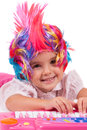 Little girl with colorful wigs Royalty Free Stock Image
