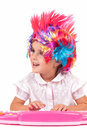 Little girl with colorful wigs Royalty Free Stock Photos