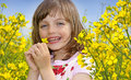 Little girl with colza flower happy rapeseed Stock Images