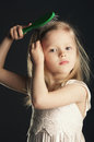 Little girl combing her long hair Royalty Free Stock Photo