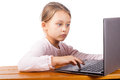 Little girl communicates over the internet with friends on a white background isolated Royalty Free Stock Photo