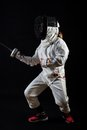 Little girl in complete fencing costume and epee pronation tierce position Royalty Free Stock Photos